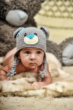 Baby in gray hat Royalty Free Stock Photography