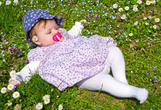 Baby on green Stock Images