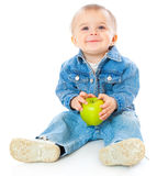 Baby with green apple Royalty Free Stock Photography