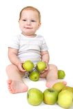 Baby with green apples Stock Photos