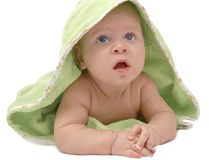 Baby in a green blanket Stock Photo