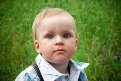 Baby in green grass Royalty Free Stock Photo
