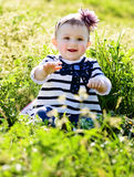Baby in green grass Stock Images