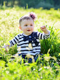 Baby in green grass Royalty Free Stock Images