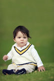 Baby on green hill Stock Photography