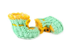 Baby green knitted booties Royalty Free Stock Images