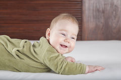 Baby green onesie smiling Royalty Free Stock Image