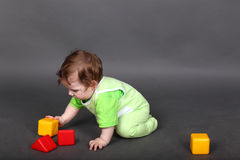 Baby in green sliders crawling Royalty Free Stock Image