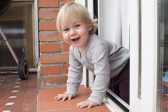 Baby greeting peering terrace Stock Image
