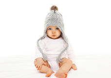 Baby in grey knitted hat on white background. Baby in grey knitted hat on a white background Stock Photos