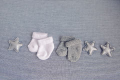 Baby grey and white socks. With leather stars Stock Photos