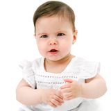 Baby gril has something to say. Portrait of cute little baby girl with funny face expression. Isolated on white background Stock Photography