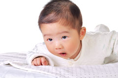 Baby groveling on the bed 2 royalty free stock photography