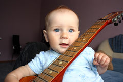 Baby and guitar Stock Photography