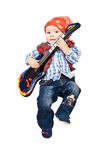 Baby guitarist. Jumping baby with toy electric guitar Stock Image