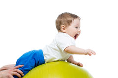Baby on gymnastic ball Stock Image