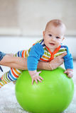 Baby gymnastic. Baby playing with gymnastic ball with mother at home Stock Photo