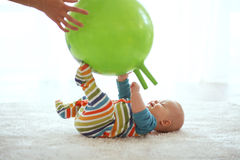 Baby gymnastic. Baby playing with gymnastic ball with mother at home Royalty Free Stock Photos