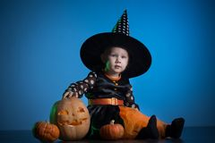 Baby in Halloween costumes,. Girl two years old stock photos