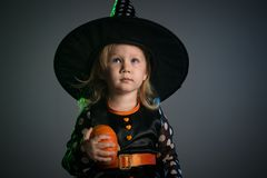Baby in Halloween costumes,. Girl two years old royalty free stock photos