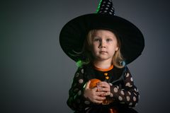 Baby in Halloween costumes,. Girl two years old stock photography