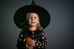 Baby in Halloween costumes,. Girl two years old stock photo