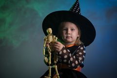 Baby in Halloween costumes,. Girl two years old stock image