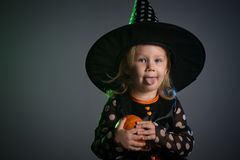 Baby in Halloween costumes,. Girl two years old royalty free stock images