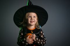 Baby in Halloween costumes,. Girl two years old royalty free stock photography