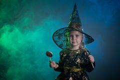 Baby in Halloween costumes,. Girl two years old royalty free stock image