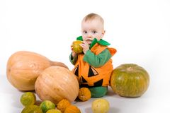 Baby in a Halloween pumpkin costume Stock Photography