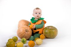 Baby in a Halloween pumpkin costume Stock Photos
