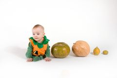 Baby in a Halloween pumpkin costume Stock Images