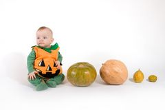 Baby in a Halloween pumpkin costume Royalty Free Stock Photo