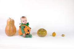 Baby in a Halloween pumpkin costume Royalty Free Stock Image