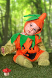 Baby in a halloween pumpkin costume Stock Photo