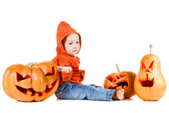 Baby and Halloween pumpkin. Isolated on white Stock Images