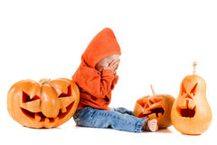 Baby and Halloween pumpkin. Isolated on white Stock Image