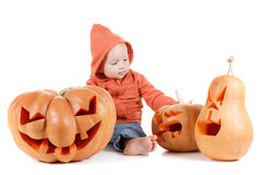 Baby and Halloween pumpkin. Isolated on white Royalty Free Stock Photos