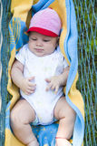 Baby in hammock Stock Images
