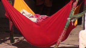 Baby hammock form colorful cradle in Jodphur, India stock footage