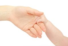 Baby hand. Holding mother finger isolated on white Stock Photos