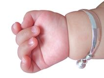 Baby hand with a bracelet Royalty Free Stock Images