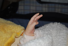 Baby hand. Child's hand on a background of yellow toy stock images