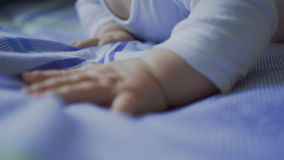 A baby hand closeup stock video footage