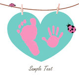 Baby hand and feet prints with heart and ladybird card Royalty Free Stock Image