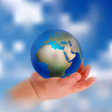Baby hand and globe. International children`s day card. Royalty Free Stock Images