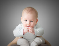 Baby with hand in his mouth Royalty Free Stock Image
