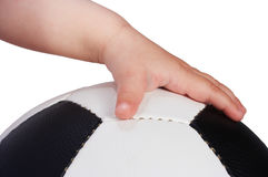 Baby hand hold soccer ball. On white Stock Photo