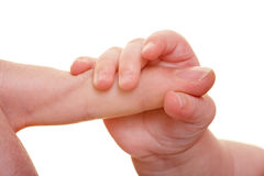 Baby hand holding adult finger Stock Photos